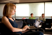 Woman in Airport Using Netbook
